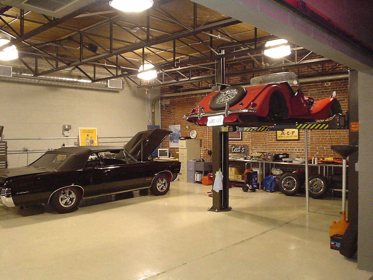 Indian springs alumni pages for Cool car garage ideas